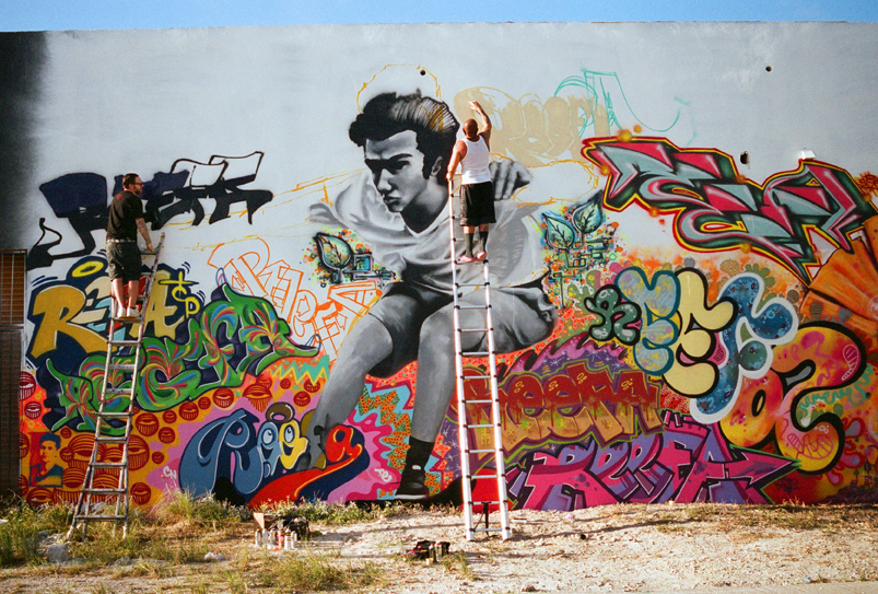 On the left is QUAKE  of MSG working on his piece for the REEFA Memorial wall in Wynwood. Pictured In the middle is ERAZE.