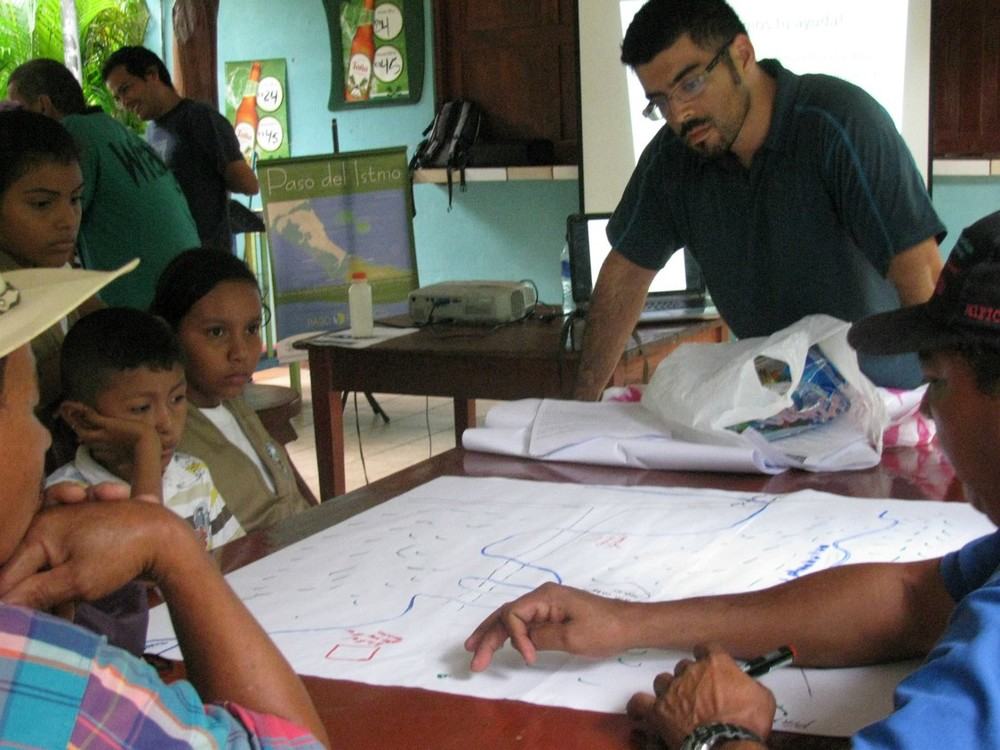 I was looking on as the community enthusiastically mapped out their village while examining the map for the best places to set up camera traps.