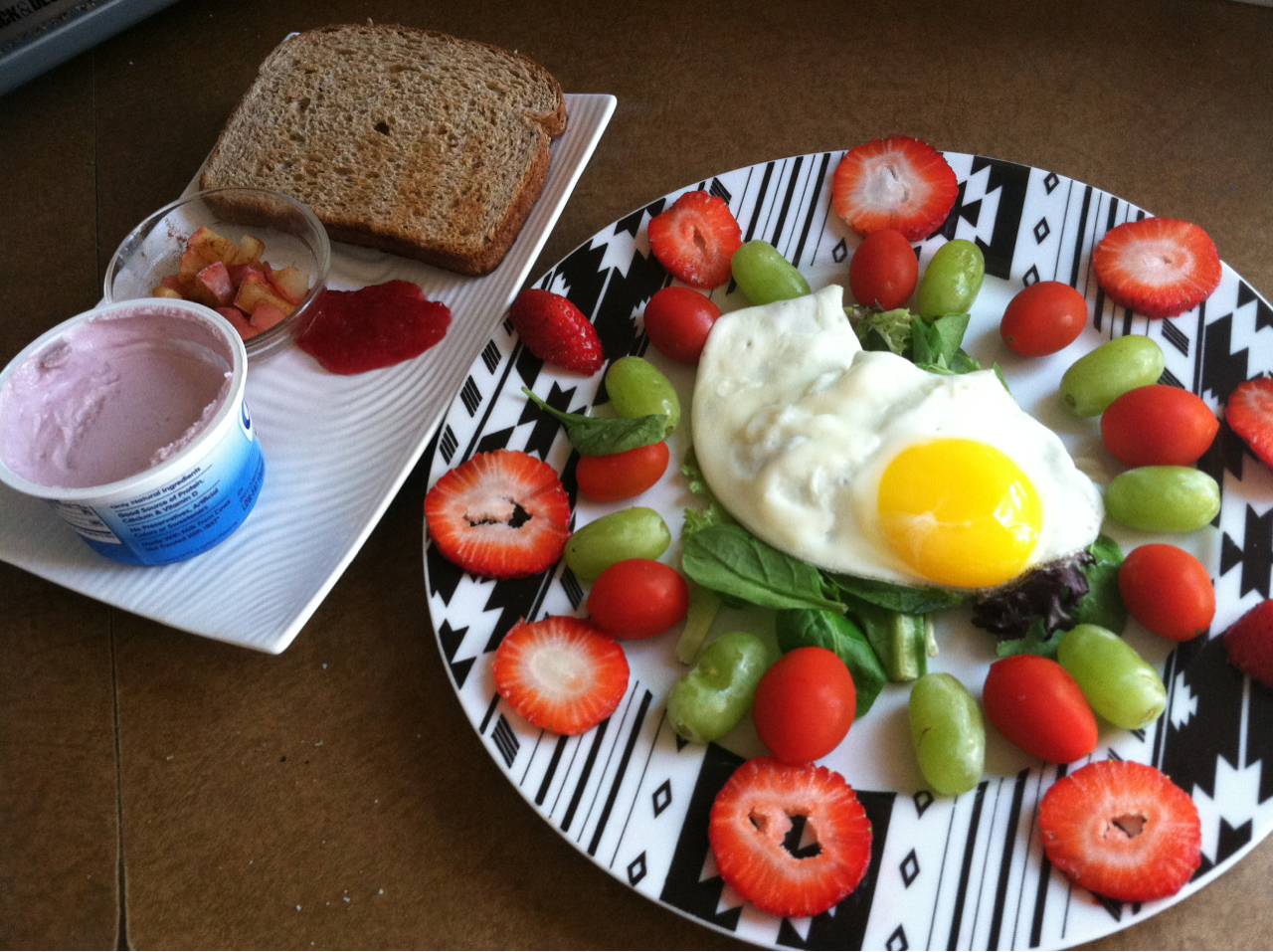 happilyfitandhealthy :     Breakie!  An egg on top of a bed of salad, tomatoes, grapes, strawberries, Greek yogurt, apple compote, and toast with jelly! :)