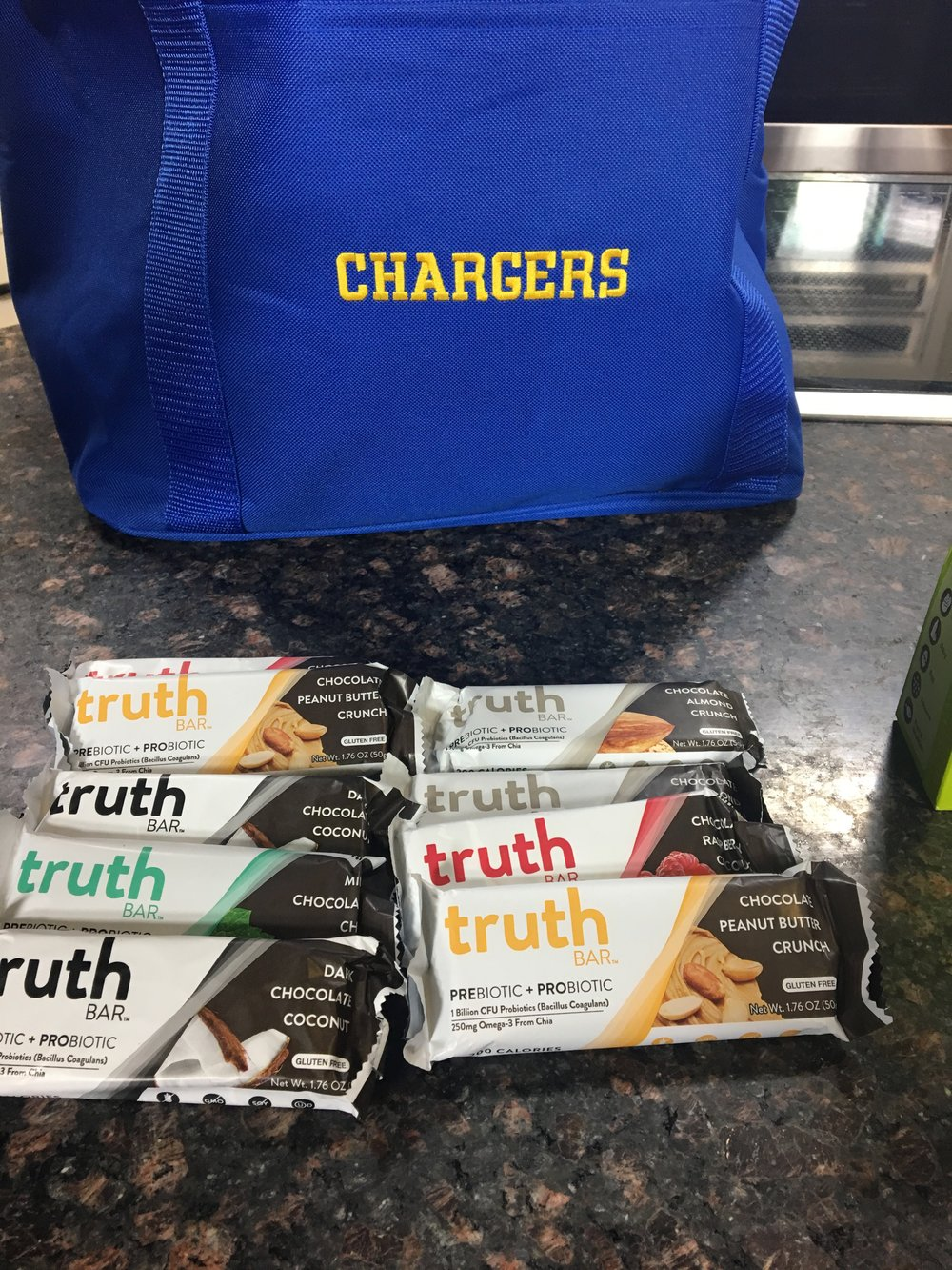 Truth Bars  have become one of my go-to bars! On the go cooler by  Initials Inc  perfect for games and grocery shopping!