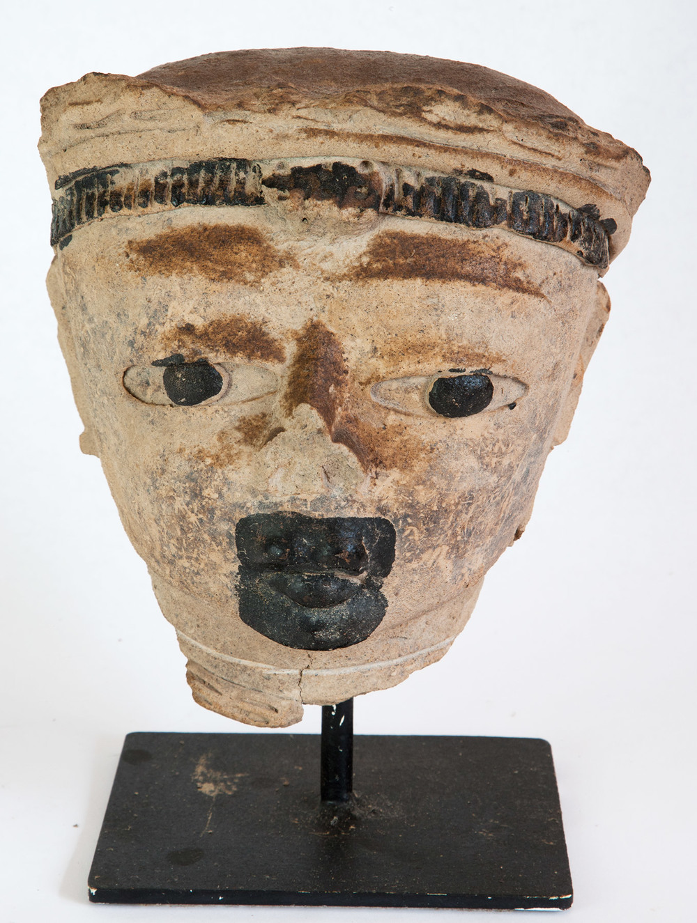 "Veracruz human head effigy. Buff terracotta with black Chapopote. 600-900 AD 7-1/2"" H"