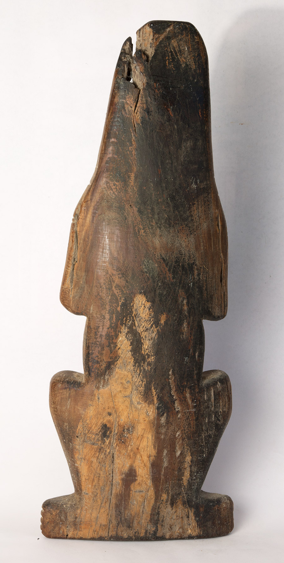 "Carib carved wood figure with hands to head. Possibly 16th century. 21"" high."