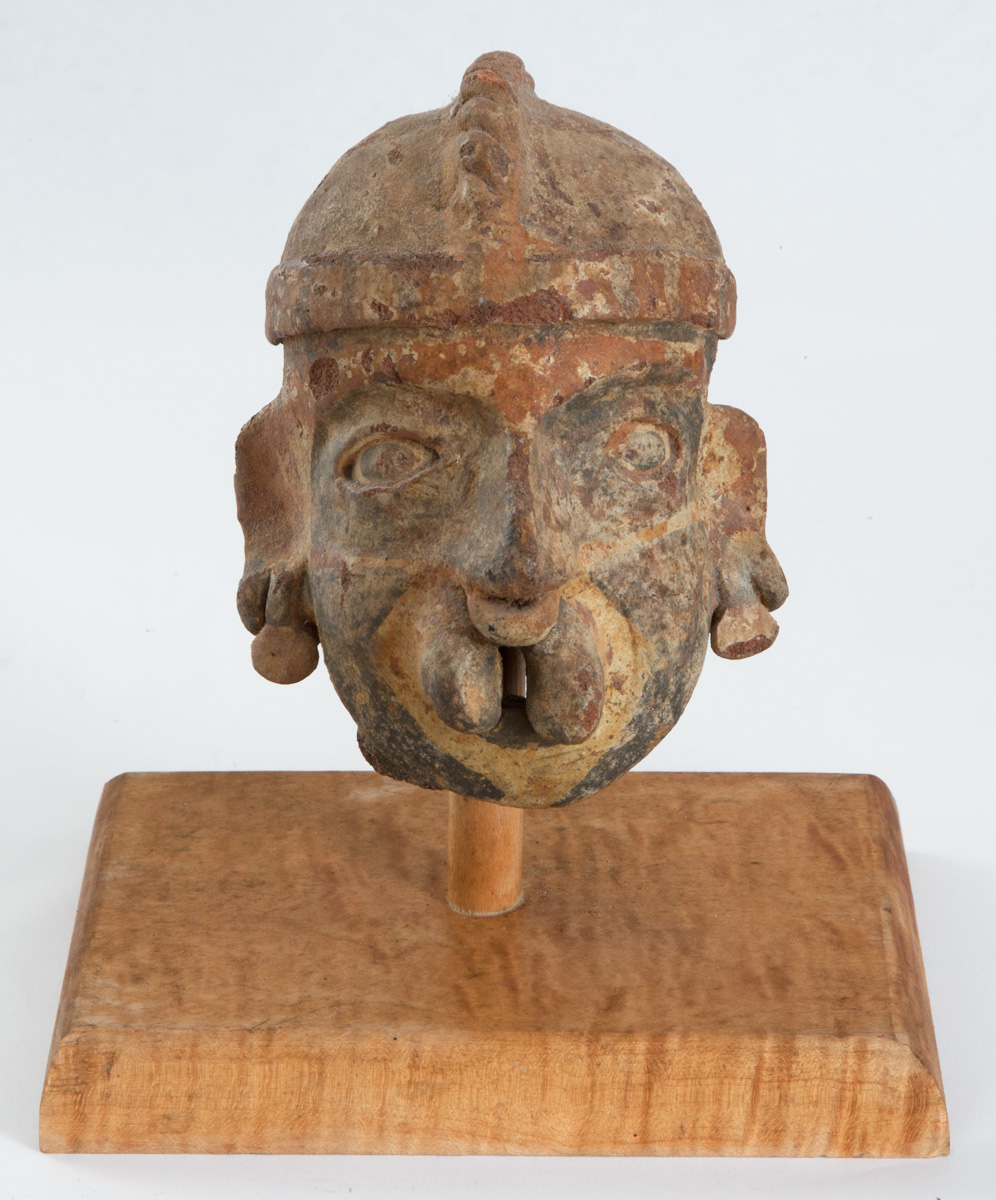 "Nayarit head from a large figure. Terracotta with polichrome paint. 200 BC-200 AD 5""x 4""x 3"""