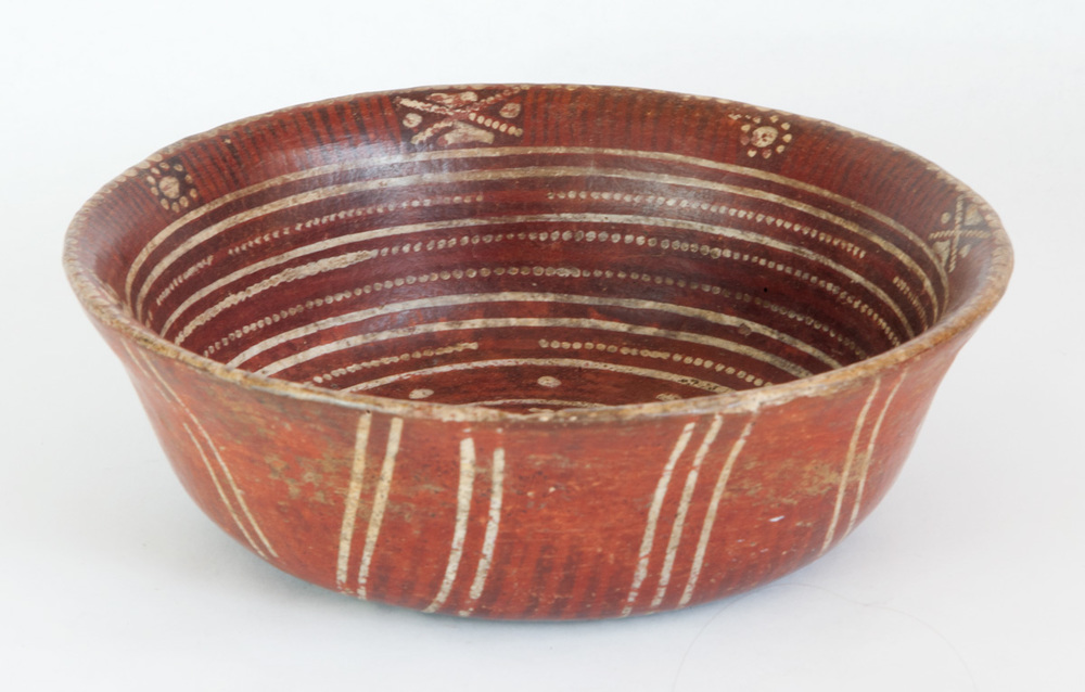 "Zacatecas bowl with red slip and white painted concentric circles. A design, possibly astronomical, alternates around the inner rim. 200 BC-200 AD 8"" dia x 2-1/2"" high"