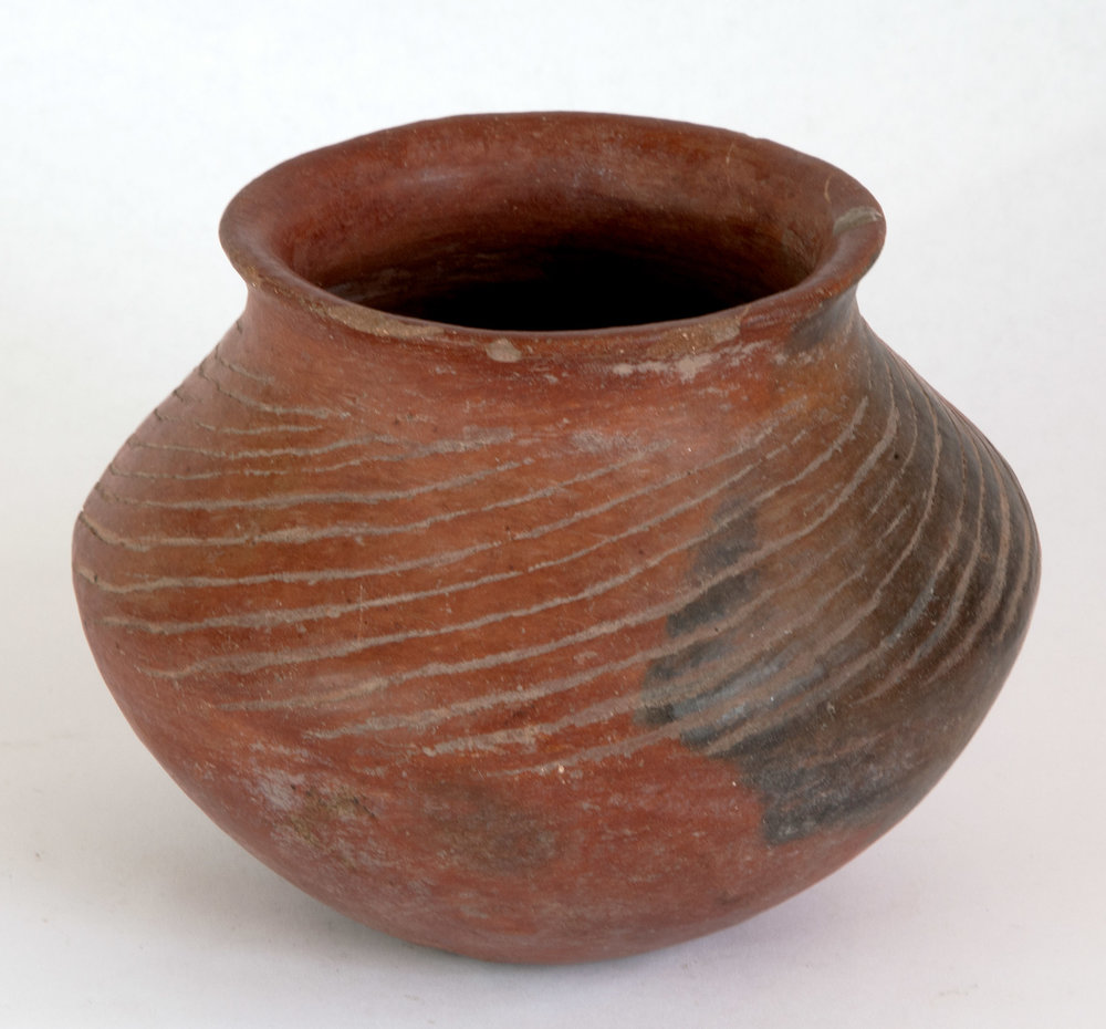 "Colima red slipped vessel with sweeping Iinear incising made before firing. 200 BC-200 AD 5"" H 6-1/2"""