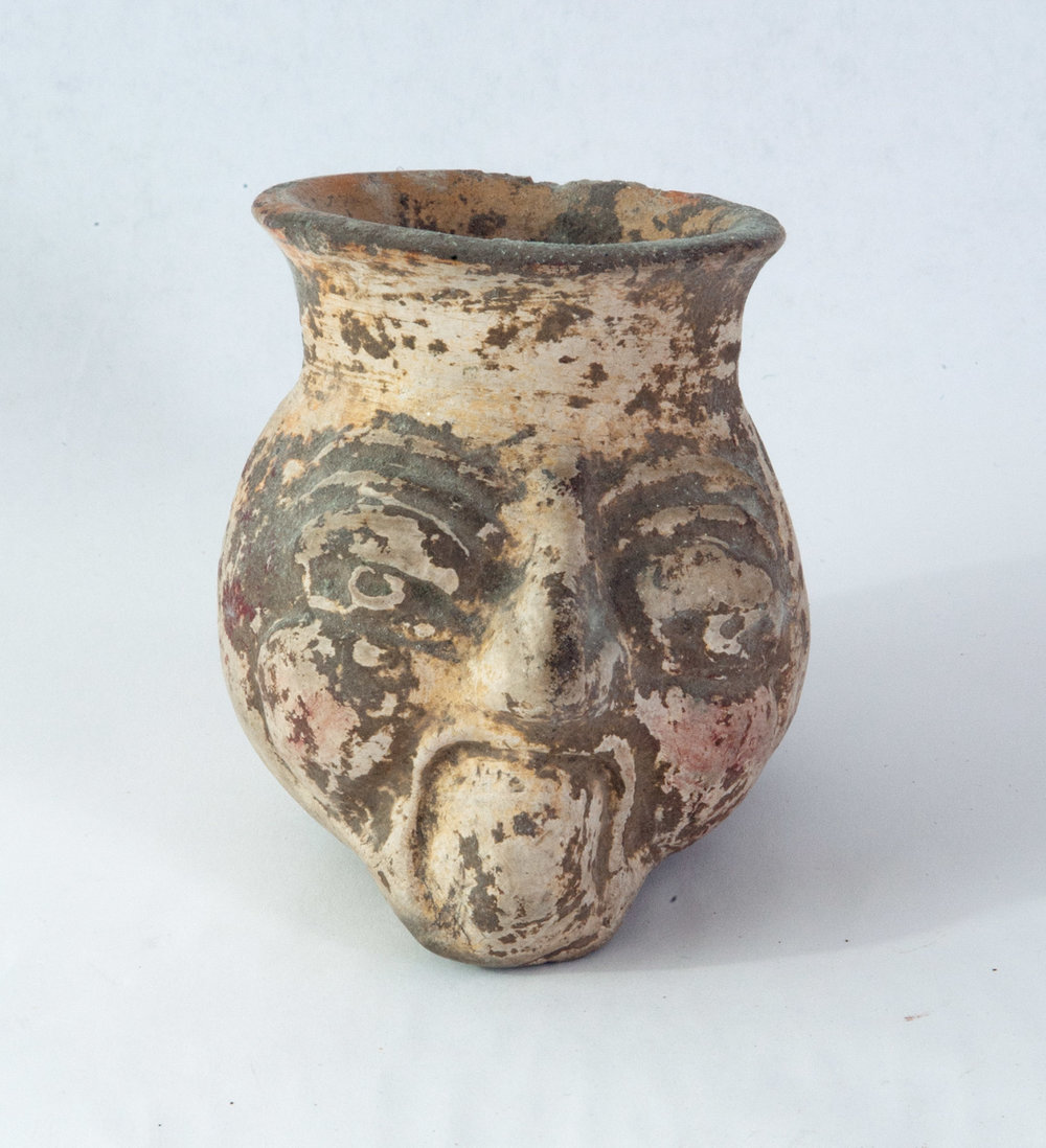 "Maya (Pacific Coast) creamware vessel in the form of an old man's head. Traces of dark red paint remain. 600-800 AD 3-1/2"" x 2-3/4"" x 3-1/4"""
