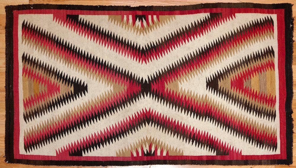 "Navajo ""eye dazzler"" carpet.  woven wool, c. 1880, 63""x37"""