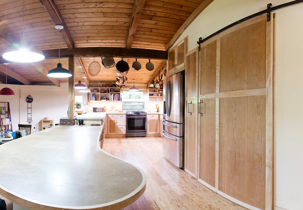 View of counter, larder and sliding door