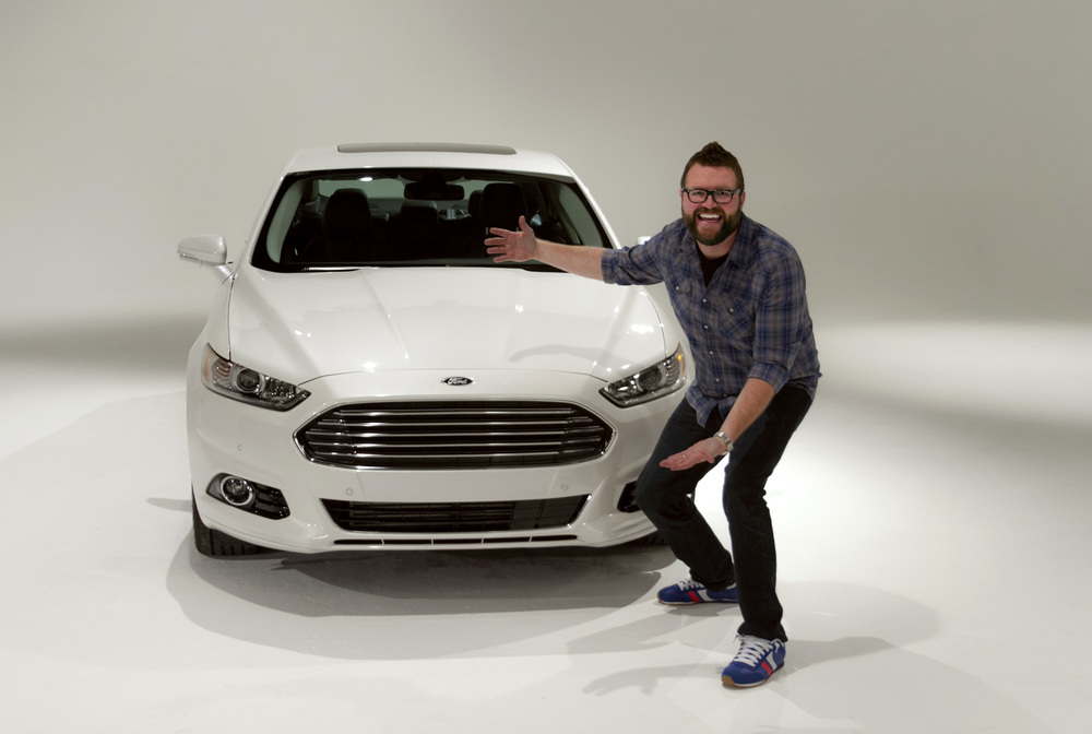 Rutledge Wood doing his best Vanna White impression with the new Ford Fusion