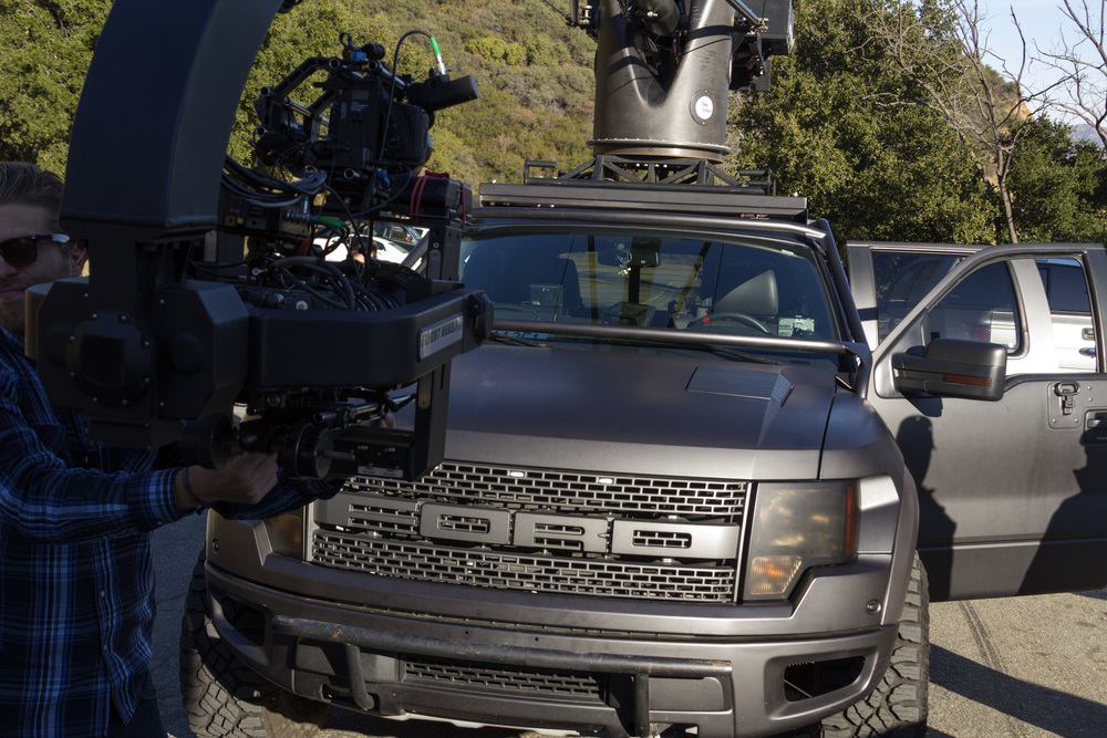 Tim Damon's blacked-out Ford Raptor camera truck means business