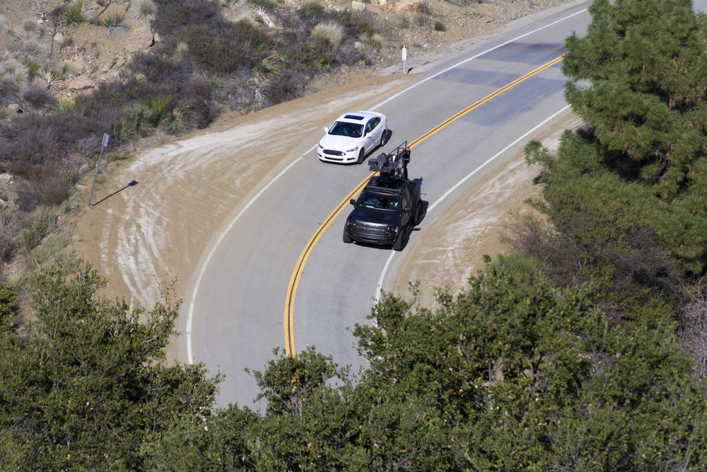 Hill-top view of the Ford Raptor camera truck shooting the Ford Fusion on Mulholland