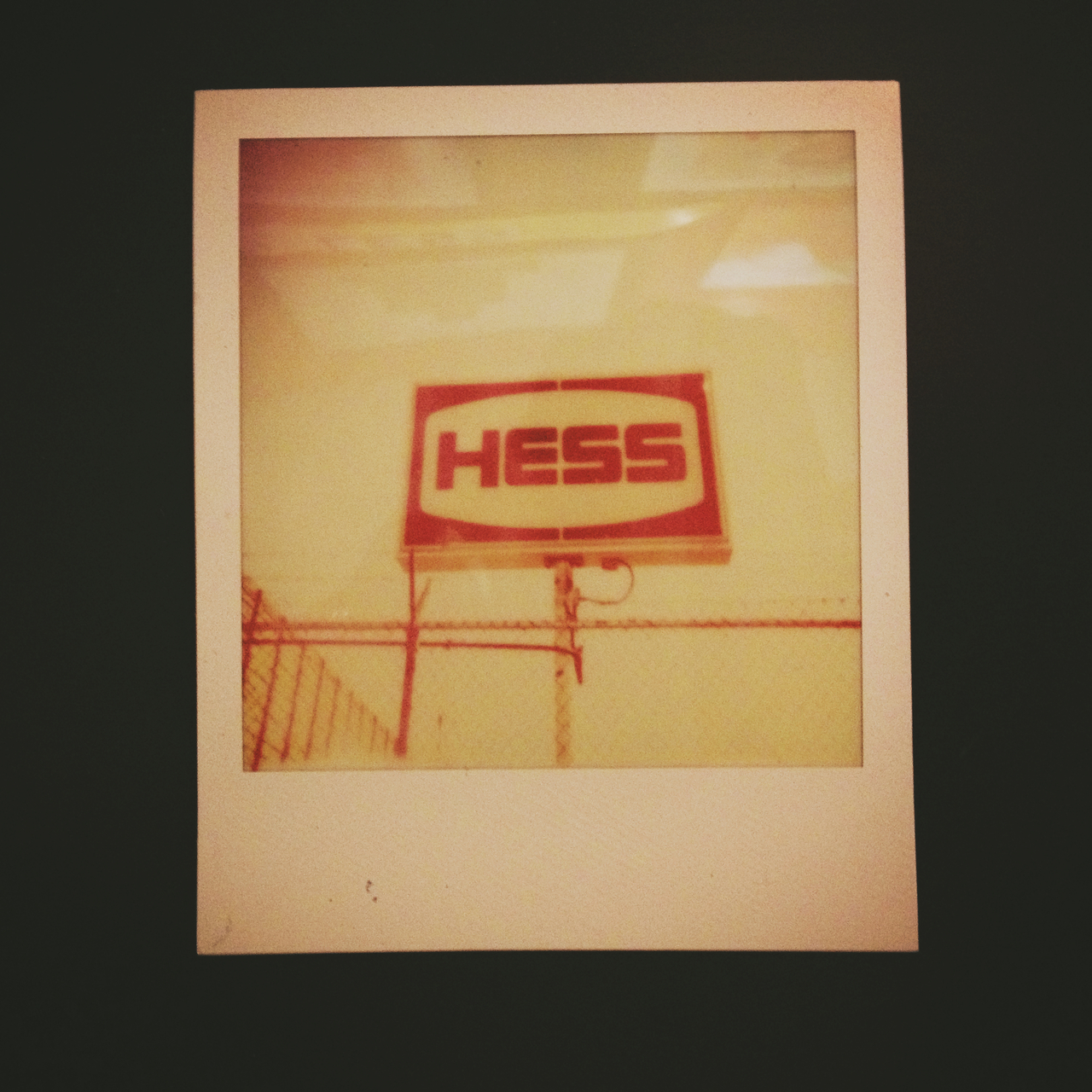 Hess Behind Gate - #pepper #peppersearching #signage #type #logo #redhook #gate #brooklyn #design #nofilter #polaroid