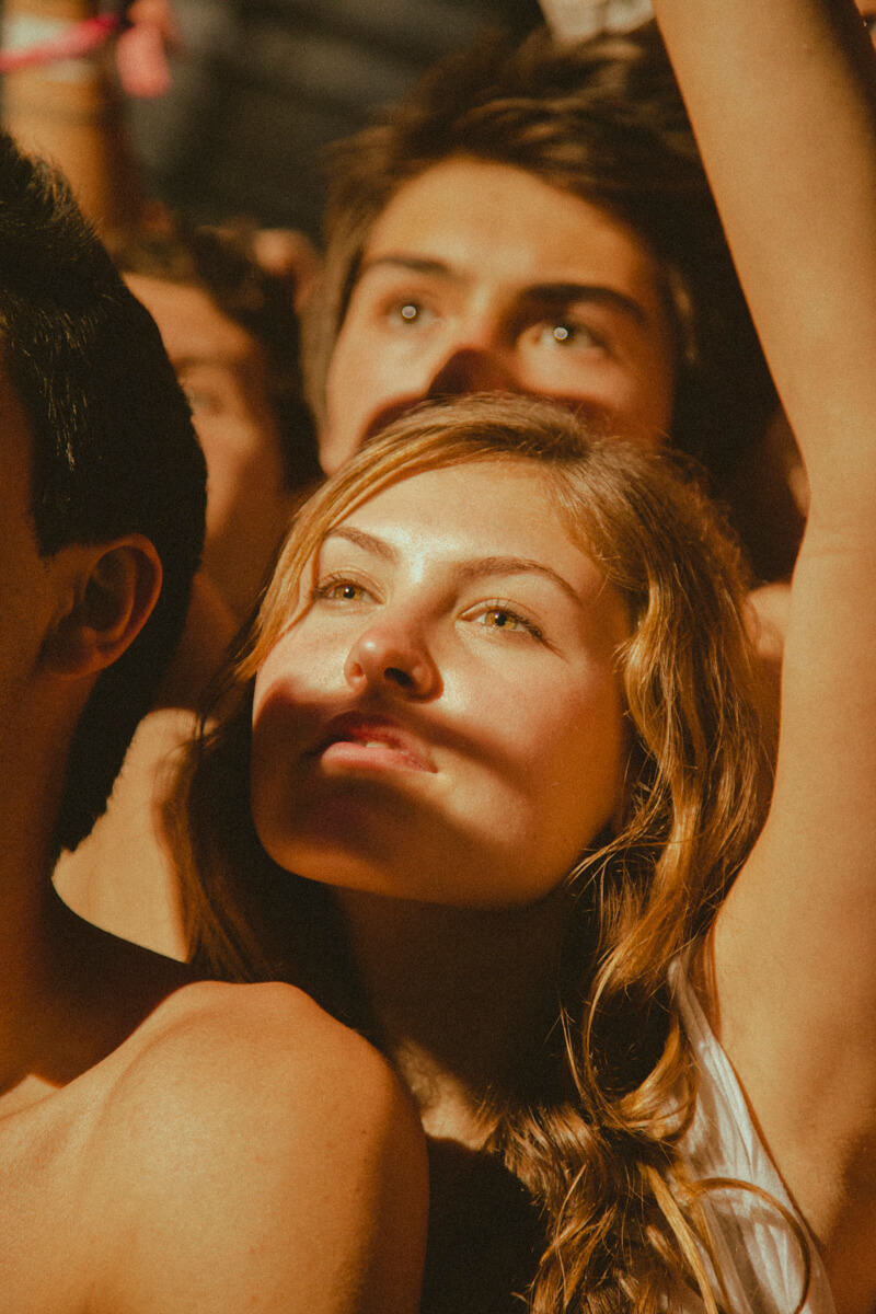 A girl amongst a sea of other people at Coachella
