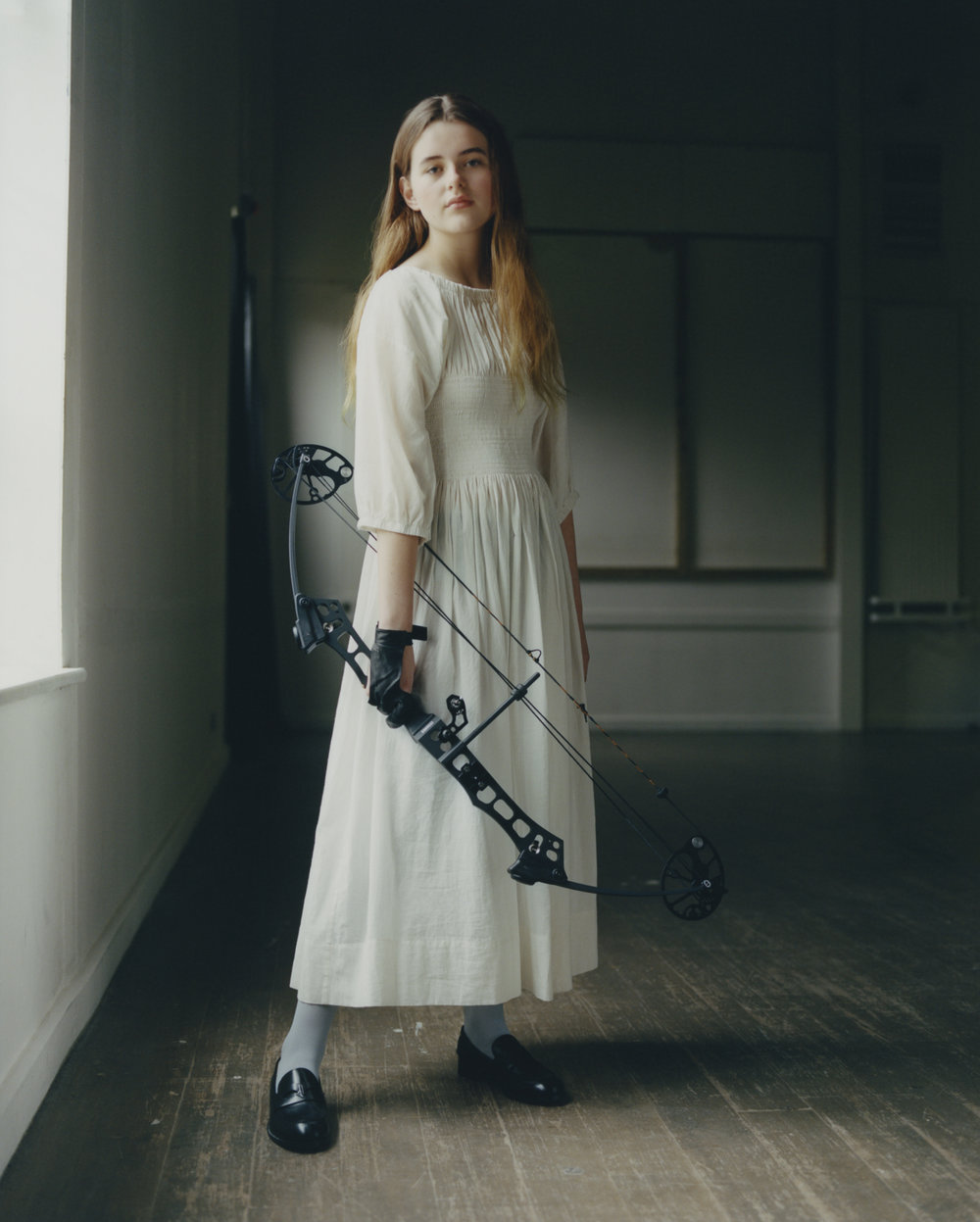 Girls with bows, as archery takes centre stage when accessorised with the latest collections; for  Twin Magazine , 2018