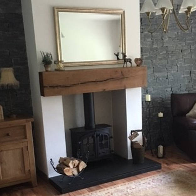 We get many requests from clients for  Oak and Pine Beams , in this case our client chose to use an oak beam as a mantle above their wood burning stove. Bow ties were used to ensure the crack did not spread as the client felt it gave the beam more character. It was then finished with a rugger brown stain wax.