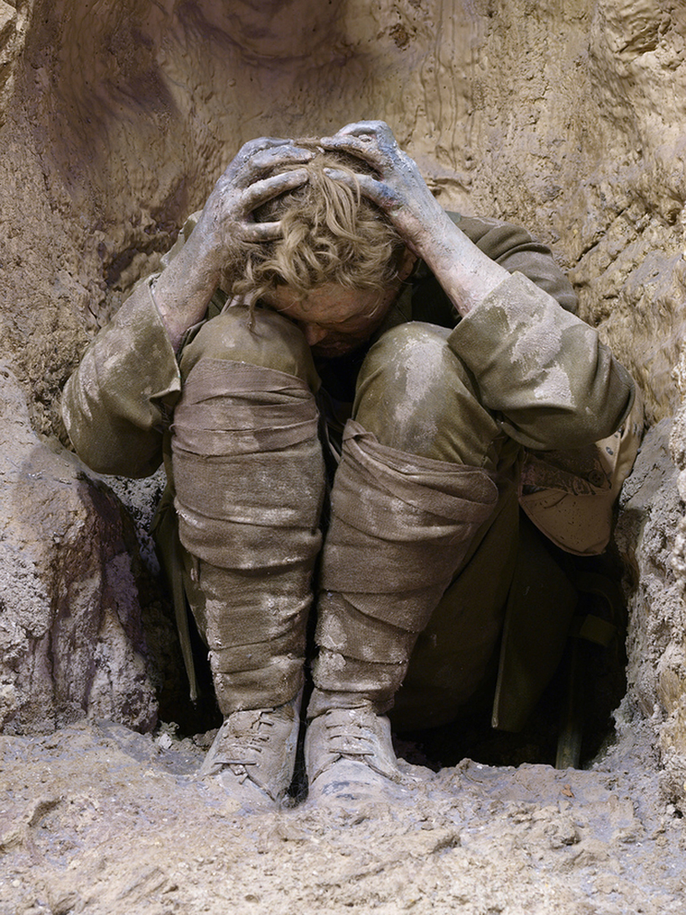 An exhibition of a soldier in a trench suffering from shell shock. For thousands of soldiers in the Great War, the fear, paranoia hysterical crying, terrible nightmares, mutism, fatigue, facial tics, and tremors were symptomatic of shell shock.