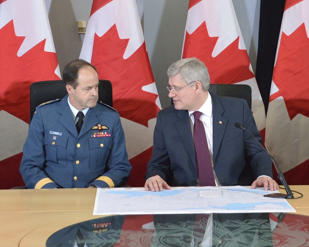 Prime Minister Stephen Harper, joined by General Tom Lawson, during a recent announcement of measures Canada will take to promote security and stability in Central and Eastern Europe, in Ottawa,  on April 17, 2014. (Combat Camera)