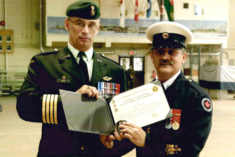 Joe Thomas, right, has won several awards and commendations — both during his time in the Canadian Forces and as a Commissionaire.