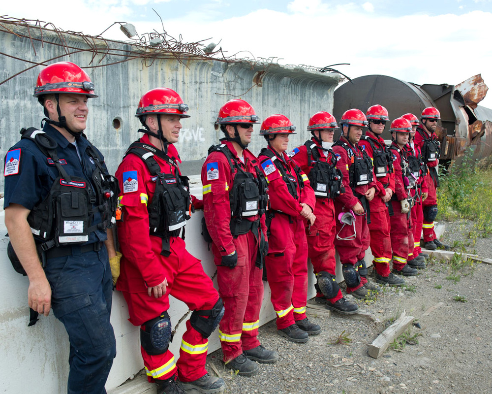 Members of Canada Task Force 2 (CAN TF2) pose for a photo-op during training. CAN TF2 was deployed in June 2013, by the Province of Alberta during the Calgary flood. They provided 64 members over 14 days to provide evacuation, rescue, and recovery to 100,000 citizens affected by the flood. (Cantf2.com)