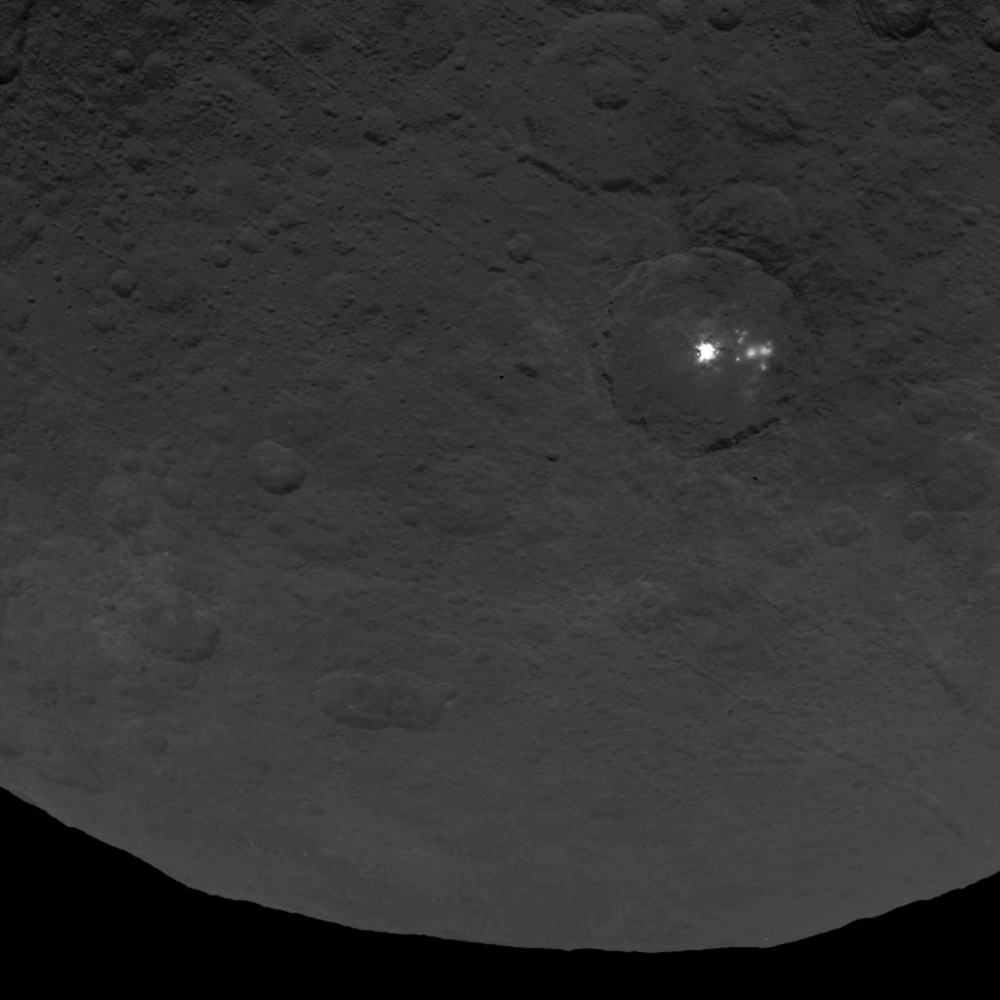 A photo of the bright spots found on the surface of Ceres. Scientists are still trying to determine what they could be. (NASA photo).