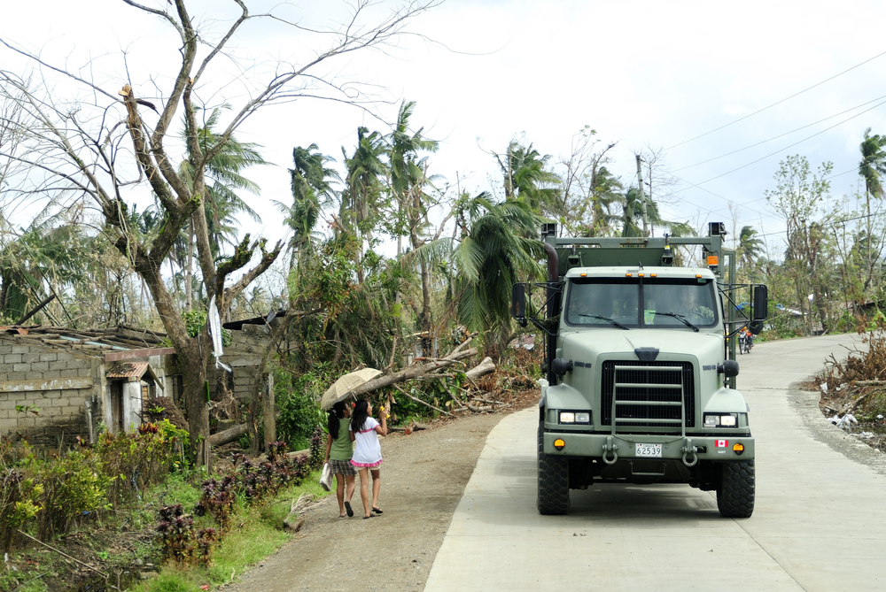 A Canadian Armed Forces medium support vehicle drives down the road in Roxas City, Philippines in November 2013 during Operation RENAISSANCE. These vehicles will be replaced under the Medium Support Vehicle System (MSVS) project, the contract for which will be awarded any day. Delays in completing the in part forced the government to announce the Defence Procurement Strategy. (Cpl. Darcy Lefebvre, DND)