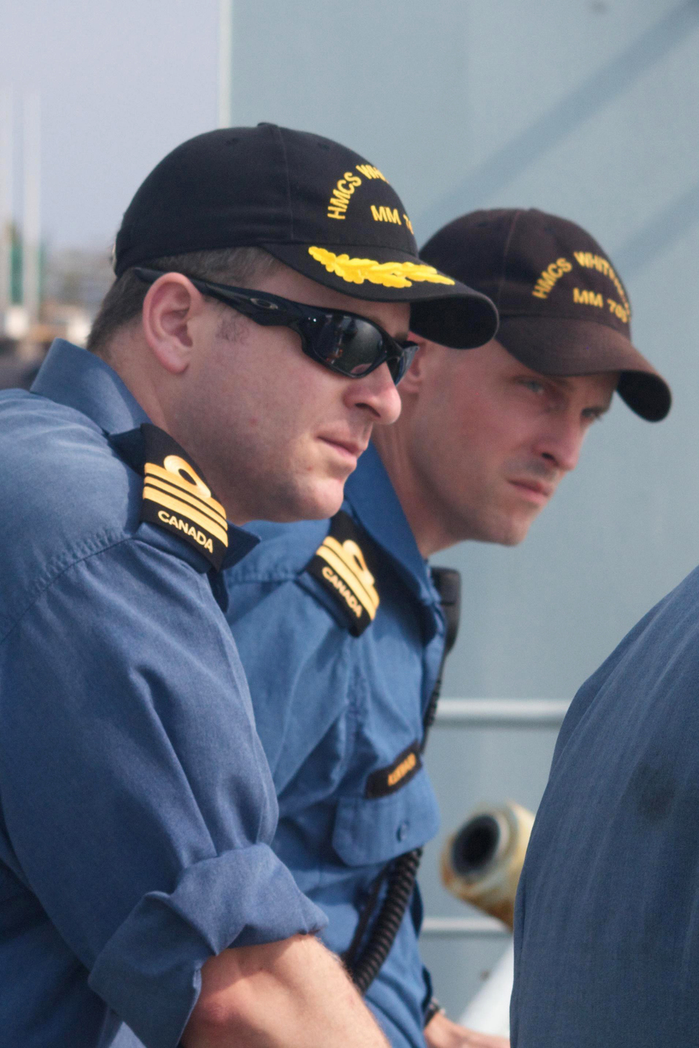 LCdr Christopher Rochon (left) oversees the line handling during an alongside, with the ship's XO, Lt Lucas Kenward, at Puerto Quetzal, Guatemala, on March 16, 2015. (MS. William Dennis, DND)