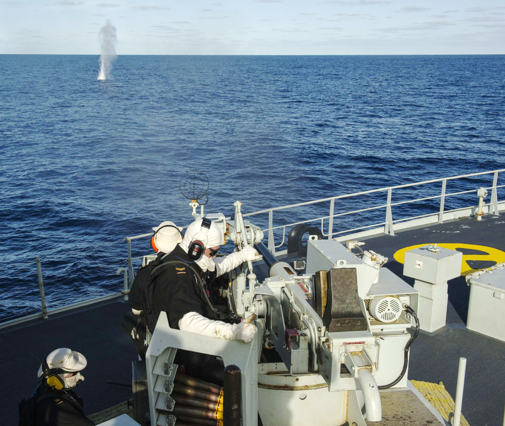 Crewmembers from HMCS Whitehorse conduct weapons maintenance on the 40mm gun while patrolling the Eastern Pacific on Operation CARIBBE. To date this year, the Royal Canadian Navy has assisted in the interception of more than 8,000 kilograms of cocaine while patrolling the Eastern Pacific and Caribbean Sea. (DND)