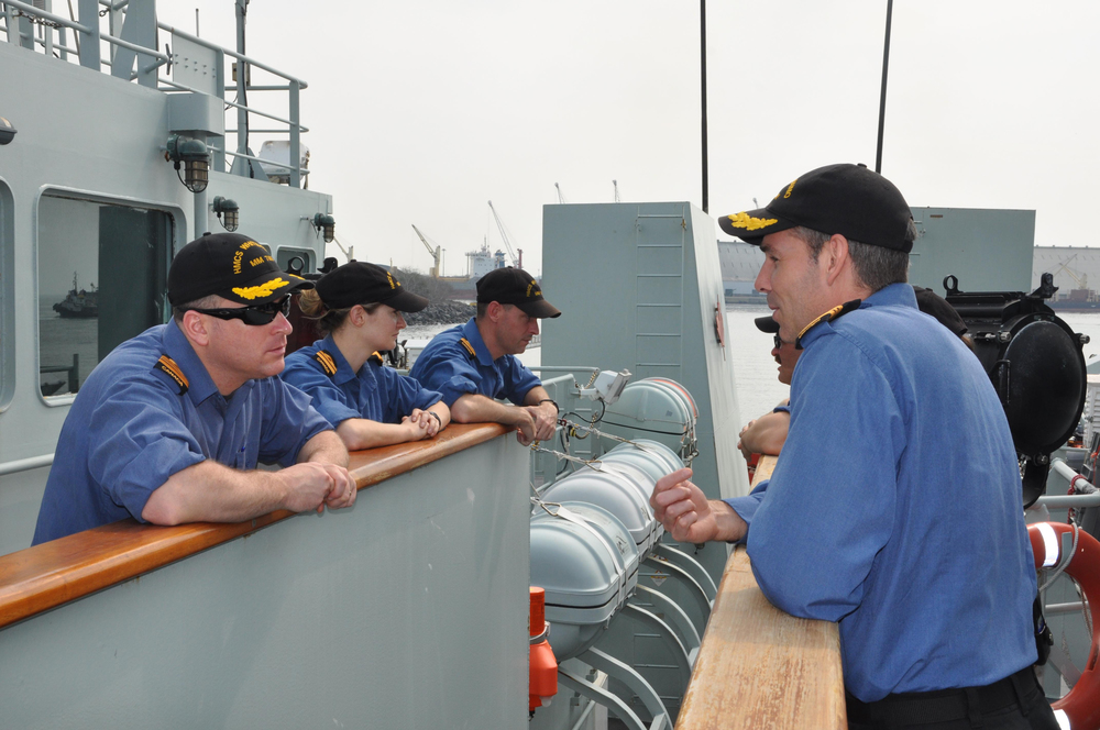 LCdr. Rochon (left), speaks with LCdr. Jeffrey Hopkins, Commanding Officer of HMCS Nanaimo (right) prior to departing from Puerto Quetzal, Guatemala on March 18th, 2015. (Lt. (N) Paul Pendergast)