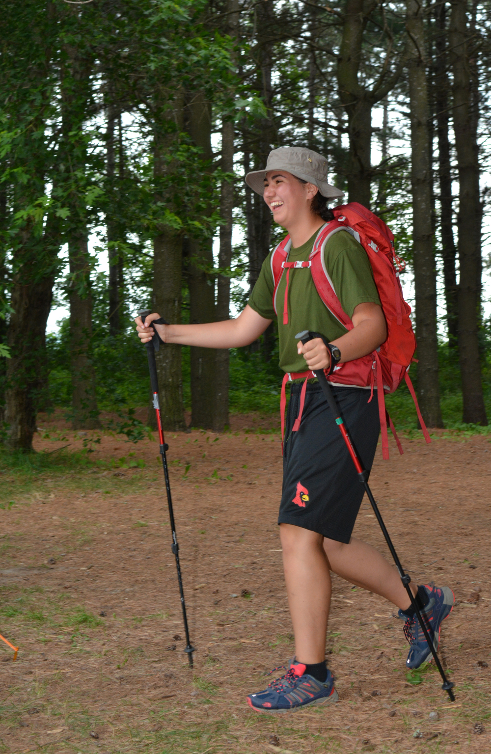 Army cadet Cristianna Giallo is all smiles as she returns from a hike at Earl Rowe Provincial Park in preparation for her 21 day excursion as part of her training in the Expedition Instructor Course at CFB Borden. (Sgt Kev Parle, DND)