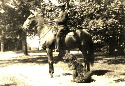 LCol Bent, at home on his fruit farm near Paradise, Nova Scotia, with the two loyal friends he brought back from the fighting in Europe. His horse Fritz, who originated in Russia and was captured by the Germans and sent to the Western Front, was eventually captured by the Canadians and became the Colonel's personal mount.  In the foreground is Bruno, the Belgian Sheepdog Bent adopted as a puppy. (15th Battalion Memorial Project)