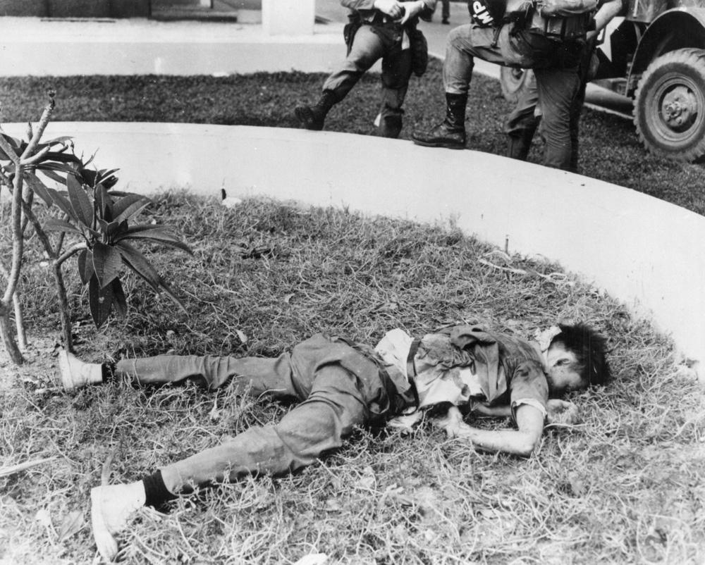"A dead Viet Cong on the grounds of the U.S. Embassy in Saigon, 31 January 1968. The West has some of the blood of the ""victims of communism"" on its own hands, writes Scott Taylor. (U.S. Army)"