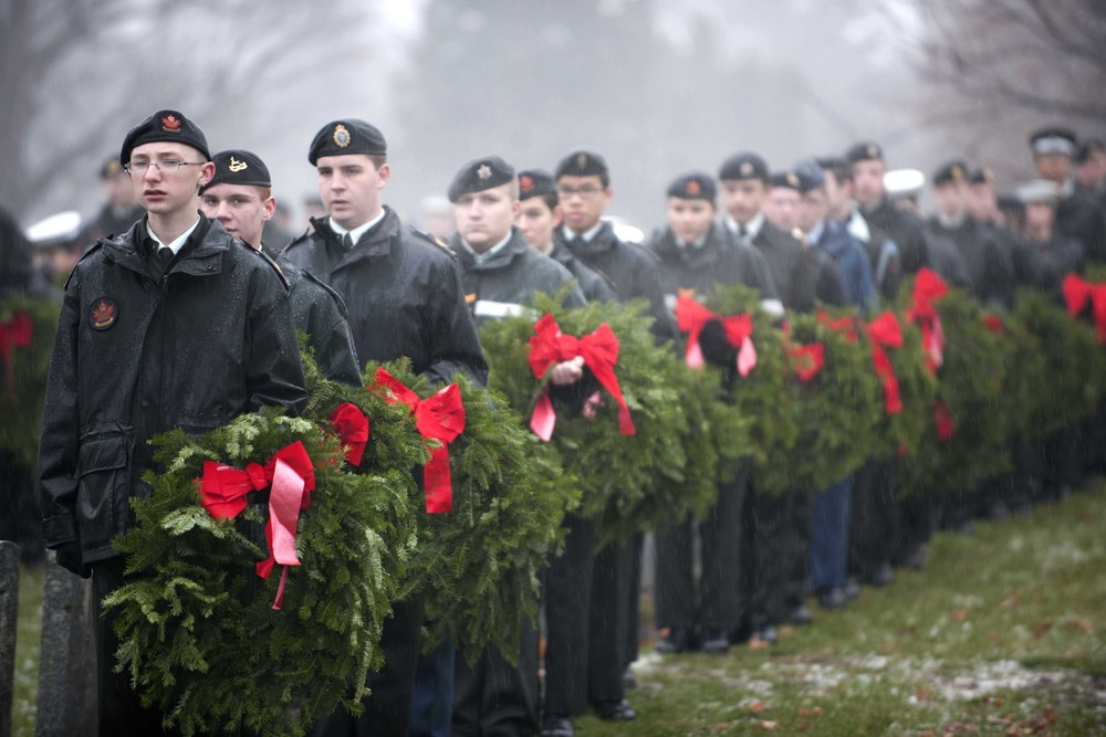 The cadet support contingent assists VIPs laying wreaths during the Wreaths Across Canada Ceremony held at the Beechwood Canadian National Military Cemetery in Ottawa, Ontario. This event serves to confirm the mission statement of Remembering, Honouring and Teaching, especially young Canadians, about those who have fallen in the line of duty, those who serve and those who have served. (mwo carole morissette, dnd)