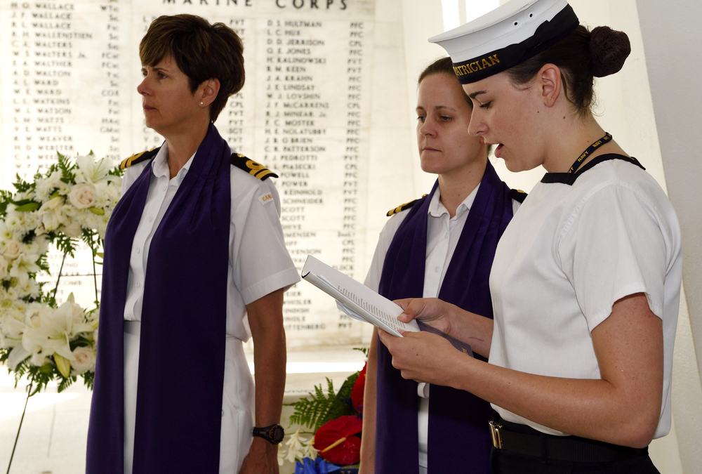 Royal Canadian Sea Cadets 256 Patricia, Petty Officer 1st Class Kevlynn Loubier from Balmertown, Ontario, reads a prayer at the USS Arizona memorial during Exercise Rim of the Pacific (RIMPAC) while in Pearl Harbor on July 3, 2014. (sgt matthew mcgregor, canadian forces combat camera)
