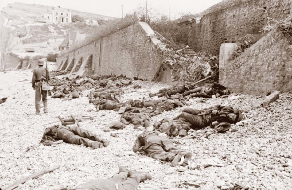 Canadian dead on Blue Beach at Puys. Trapped between the beach and high sea wall (fortified with barbed wire), they made easy enfilade targets for MG34 machine guns.
