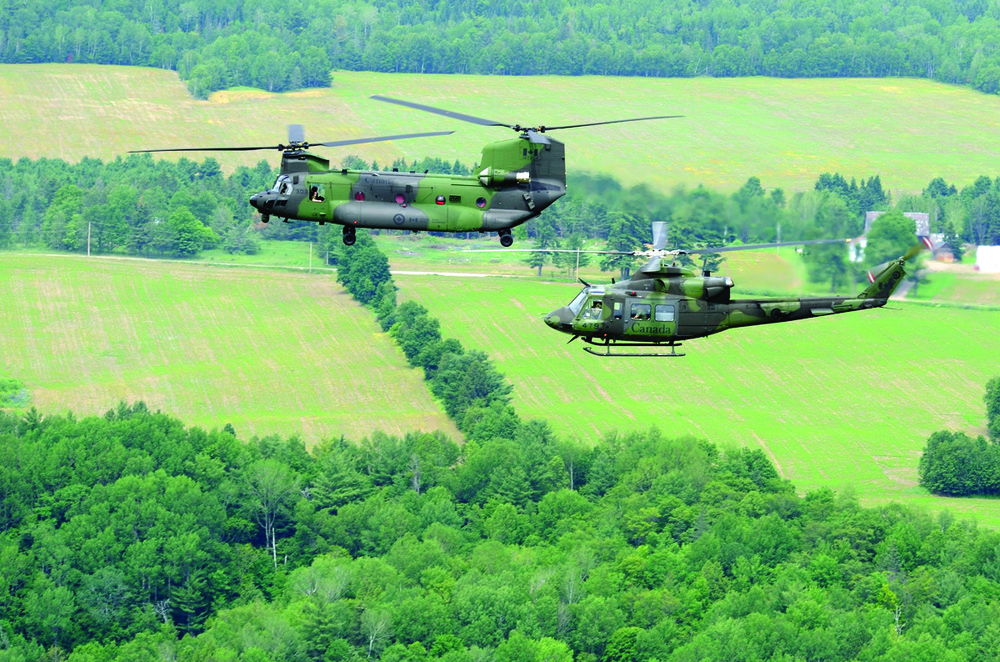 Canada's new CH-147F Chinook medium- to heavy-lift helicopter makes its way from the nation's capital, up the Ottawa Valley, to its new home at Canadian Forces Base Petawawa, Ont., on June 27, 2013. A CH-146 Griffon helicopter accompanies the Chinook. Canada and the RCAF have purchased 15 of these Boeing helicopters. (CPL DARCY LEFEBVRE, DND)