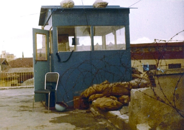 Observation Post Hermes, Nicosia, Cyprus, 1974. Notice the positioning of barb wire and sand bags to keep the bad people at bay. The sentry would sit on the chair with the radio receiver hanging out the window and within easy reach. The blue helmet is visible next to the chair, just in case. (Frank Reid)