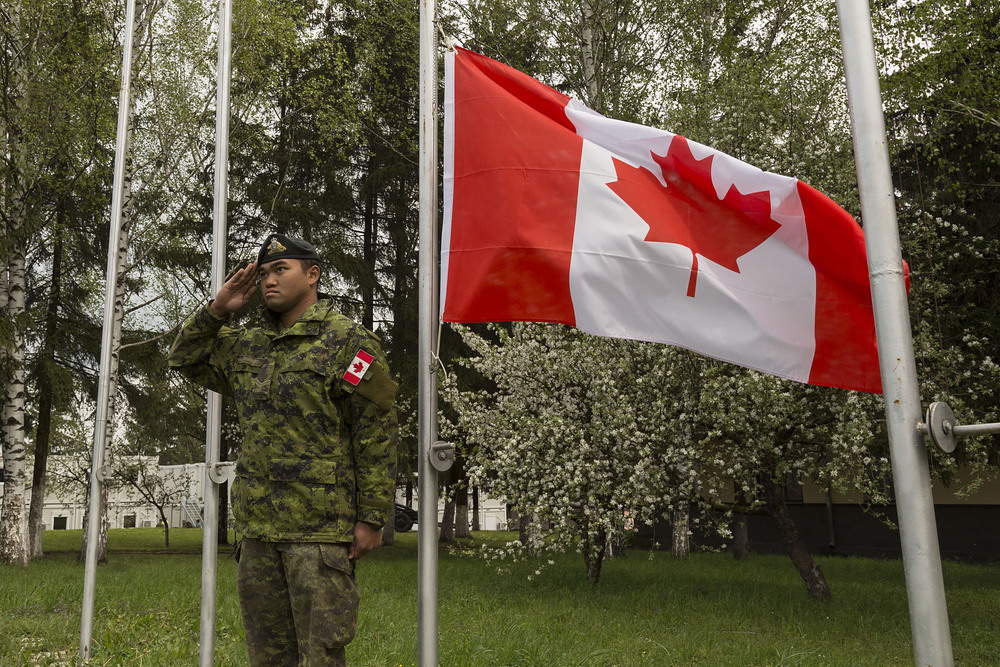 As Canadian soldiers, deployed by Canada, they should wear the Canadian flag — and only the Canadian flag — on their uniforms.