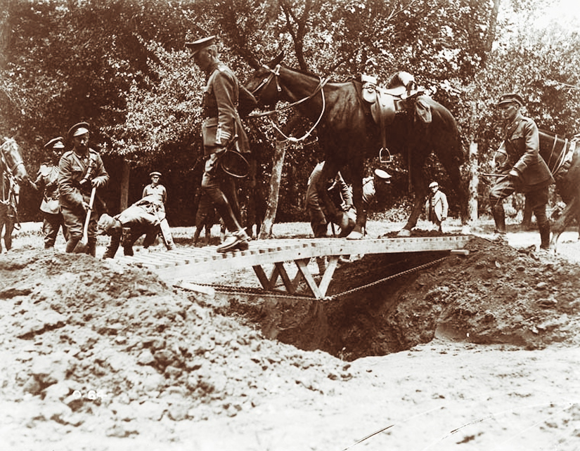 Members of the Fort Garry Horse bridge a trench in June 1916. Their legendary cavalry charge in Cambrai would forever draw comparisons to that of the British light cavalry's infamous October 25, 1854 Charge of the Light Brigade during the Crimean War's Battle of Balaclava. (Library and Archives Canada)