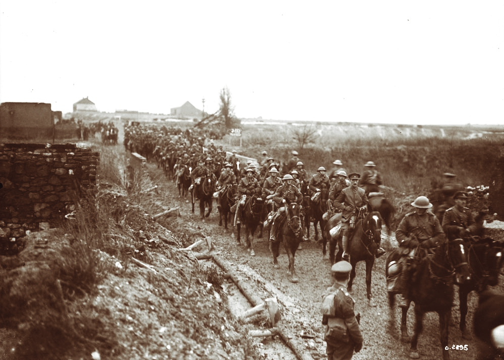 Lt Harcus Strachan leads his squadron through a village on the Cambrai front in December 1917. In May 1917 Strachan was awarded the Military Cross after a raid near Saint-Quentin. Six months later, he earned the Victoria Cross in Masnières for his gallantry in the November 20, 1917 action. Strachan would take command after the squadron leader, approaching the enemy front line at a gallop, was killed. (Library and Archives Canada)