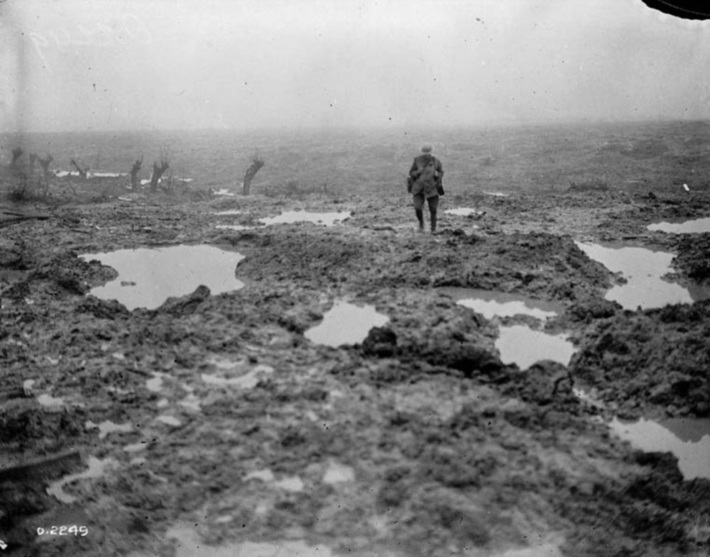 Taken in November 1917 at the height of the battle for Passchendaele this photograph illustrates why it was impossible to bury cables or set poles for airlines. The naked horizon implies the impossibility of regular repair and maintenance of lines. In the final months of the war, the terrain encountered in the Somme compelled the Canadian Corps to rely on wireless.