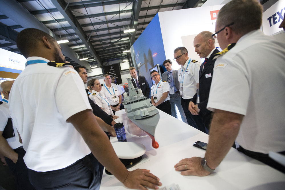 Members of the Royal Canadian Navy listen to an industry reprsentative talk about the Canadian Surface Combatant model at CANSEC 2016. (CADSI)