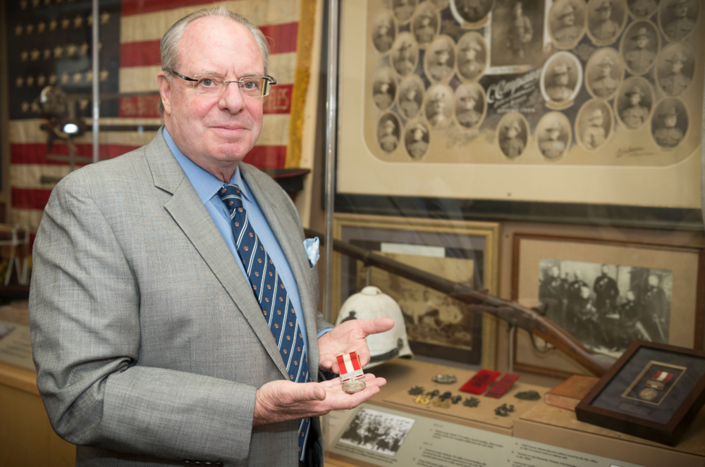 LCol (Ret'd) Dan Mackay with a Fenian Raids military medal issued to one of the soldiers of The Cameron Highlanders of Ottawa (Duke of Edinburgh's Own) in the regiment's museum at Cartier Square Drill Hall, Ottawa.