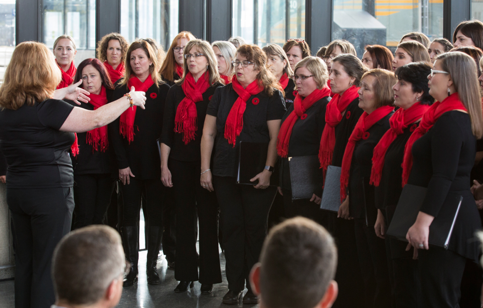 The Canadian Military Wives Choir of Ottawa performed during the press conference at the VIA Rail train station