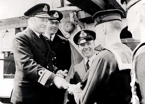 On July 29, 1942, Rear Admiral L.W. Murray presented awards to crew members of destroyer HMCS St. Croix, which sank enemy submarine U-90 just five days earlier. On April 30, 1943, Murray was promoted to Commander-in-Chief Canadian Northwest Atlantic. From his Halifax headquarters he commanded all Canadian and Allied air and naval forces involved in convoy protection in that area. He was the only Canadian officer in charge of an Allied theatre of operations during WWII.  (dnd, library and archives Canada, pa-037456)