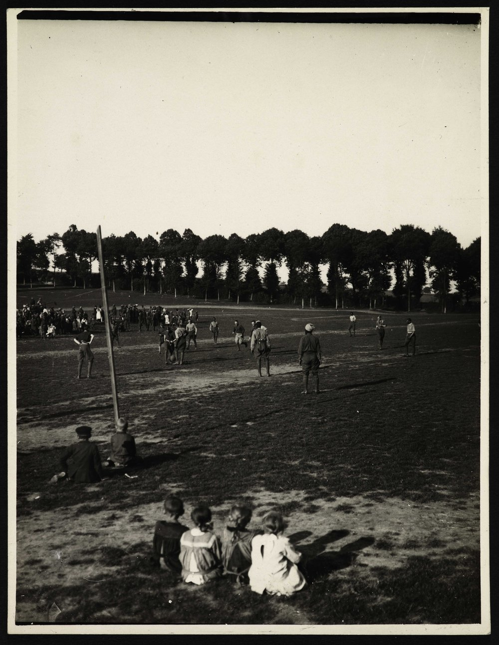 French children watch a British cavalry regiment play a match against Indian soldiers of the 18th Lancers
