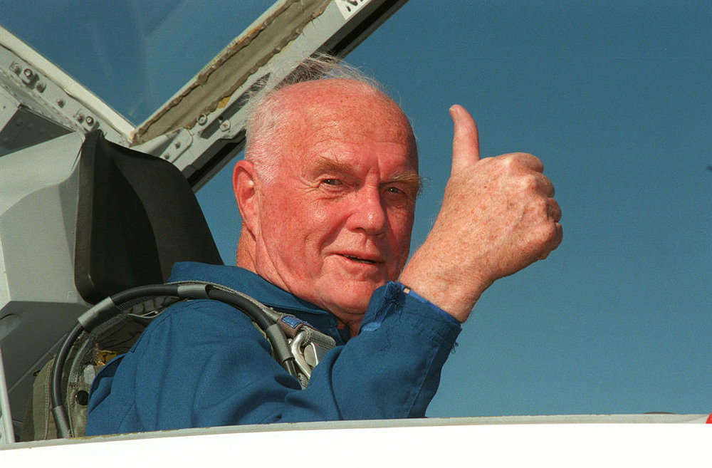 John Glenn, happily sitting in NASA's jet trainer, the T-38 Talon.