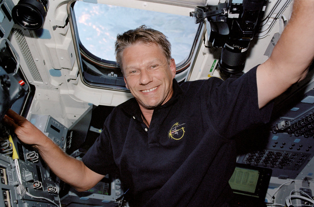 Piers Sellers joined the NASA astronaut corps in 1996 and flew to the International Space Station in 2002, 2006 and 2010, performing six spacewalks and various space station assembly tasks. As STS-112 mission specialist, Sellers is pictured above on the aft flight deck of the Space Shuttle Atlantis in 2002. (NASA photo)