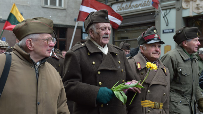 Veterans of Latvia SS Legion celebrate Nazi past at parade in Riga 16 March 2016  rt.com/news/latvia-waffen-ss-march-170/