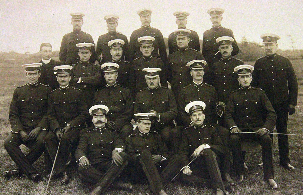 Officers of the 5th Regiment (BC), Canadian Garrison Artillery, at Macaulay Point in 1909. Currie is seated in the middle row, at left of centre.