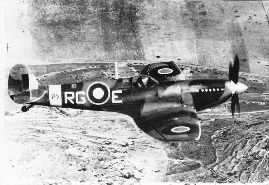 "A Spitfire Mk IX in flight during the Second World War. This is the type of aircraft Robert English was flying when he was shot down. The Spitfire was still a formidable ground attack aircraft in 1945. The majority of Mk IXs used the standard ""c"" wing, which could carry four 20mm cannon or two 20mm cannon and four .303 inch machine guns."